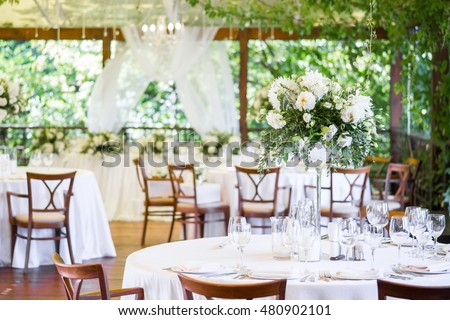 Wedding decor, table setting, floral arrangements in the restaurant ...