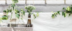 wedding decor with bottles and flowers ,the concept of the celebration and weddings