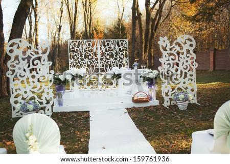 Wedding decoration in garden. Sunny autumn day.