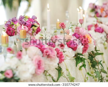 Wedding decoration on table. Floral arrangements and decoration. Arrangement of pink and white flowers in restaurant for luxury wedding event