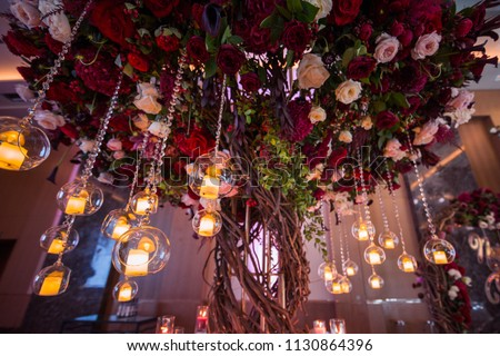 wedding decorations with flowers and candles. banquet decor. picture with soft focus #1130864396