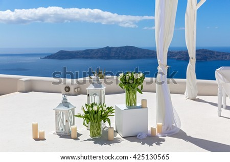 Wedding decorations with white tulips on the background of the sea #425130565
