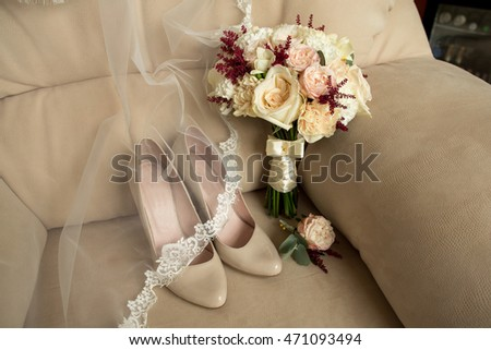 Wedding details. Bouquet and bridal shoes on luxury armchair  #471093494