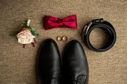 Wedding details. Groom accessories. Shoes, rings, belt, and bowtie