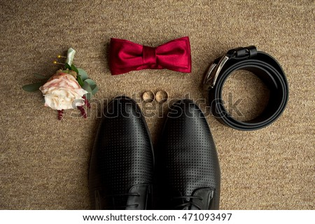 Wedding details. Groom accessories. Shoes, rings, belt, and bowtie #471093497