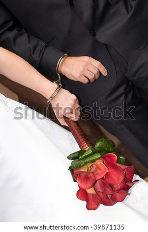 stock photo wedding details newlyweds in handcuffs