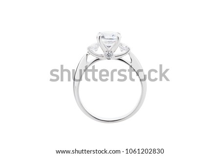 Wedding diamond ring isolated on a white background. Silver engagement ring with gemstone