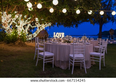 wedding dinner setup - Shutterstock ID 667154245