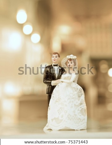 stock photo wedding doll with gold background