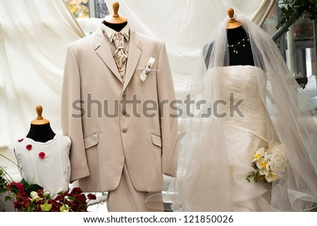 Wedding dress and suit in the store