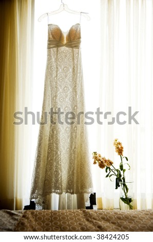 stock photo Wedding dress hanging in window