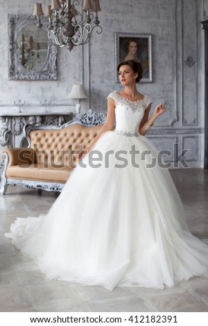 Wedding dress in Paris. Bride in a luxury apartment in a wedding dress.