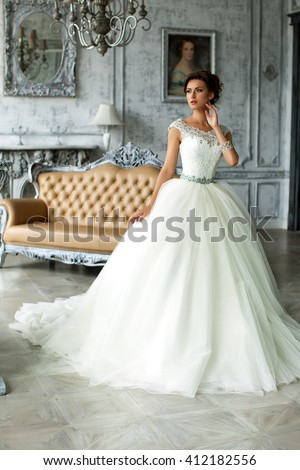 Stock Photo Wedding dress in Paris. Bride in a luxury apartment in a wedding dress.