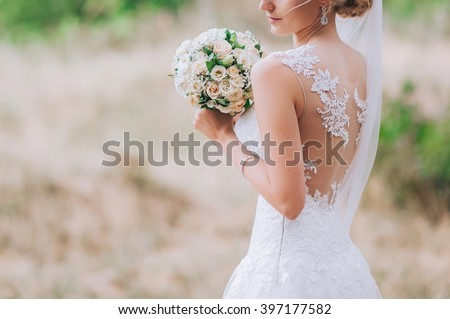 Shutterstock wedding dress, wedding rings, wedding bouquet