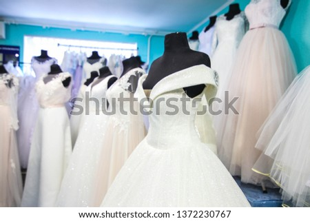 wedding dresses and dresses in the wedding salon
