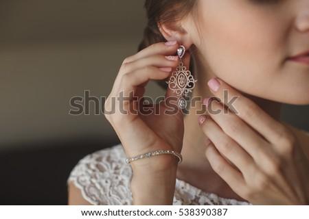 wedding earrings on a female...