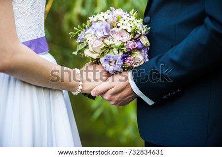 wedding flowers and lovers arms