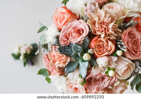 Photo of Wedding flowers, bridal bouquet closeup. Decoration made of roses, peonies and decorative plants, close-up, selective focus, nobody, objects