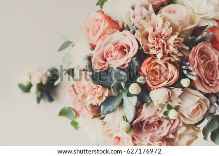 Wedding flowers, bridal bouquet closeup. Decoration made of roses, peonies and decorative plants, close-up, selective focus, nobody, objects #627176972