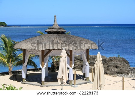 wedding gazebo on the beach in front of the ocean