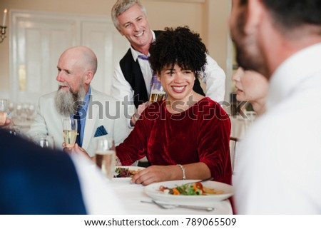 Wedding guests are socialising while enjoying the starter of their meal. #789065509