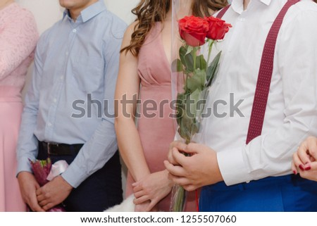 Wedding guests with flowers #1255507060