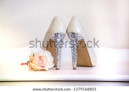 Wedding high-heeled shoes decorated with jewelry shiny stones #1379568803