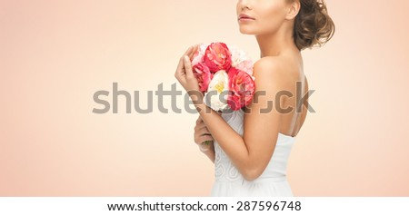 wedding, holidays, people and celebration concept- bride or woman with bouquet of flowers over beige background
