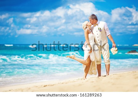 wedding in bali - kissing bride and groom