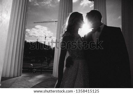 Wedding in greece. Groom and bride stand by the big column #1358415125