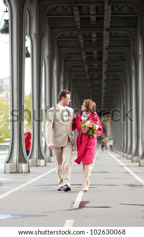 Wedding in Paris. Happy newlywed couple walking together just after their wedding