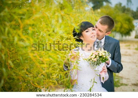 wedding in the fall. bride and groom among yellow leaves