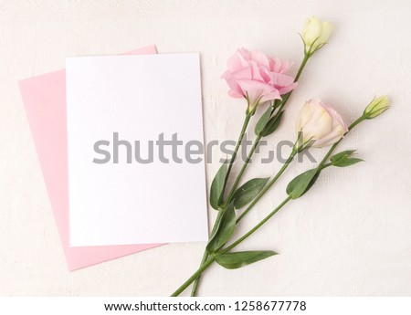 Wedding invitation mockup with white ribbons and flowers in blush colors #1258677778