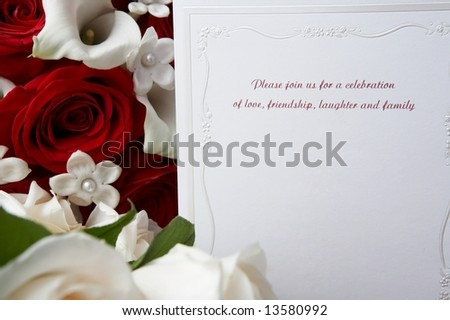 Wedding invitation with red and white roses