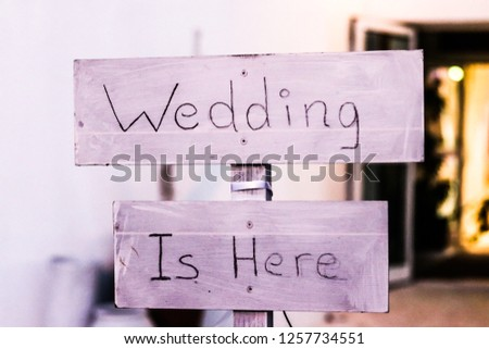 wedding is here. wedding party sign on wood #1257734551