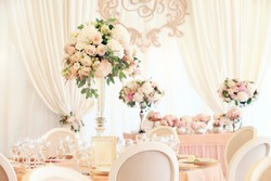 Wedding marquee flower banquet decoration in tender color. Classic light and elegance wedding table decoration concept