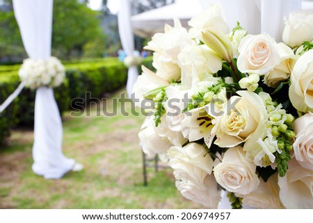 wedding marquee with bouquets of roses #206974957