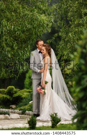 Wedding, marriage. Bride and groom in love. Newlywed couple embracing in park. #1408443575
