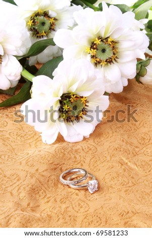 stock photo Wedding or engagement ring with white flowers