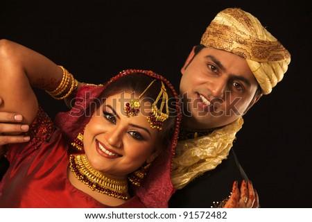 wedding photo shoot on black ground / bride and groom - stock photo