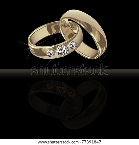 stock photo Wedding platinum rings with brilliants on the black background
