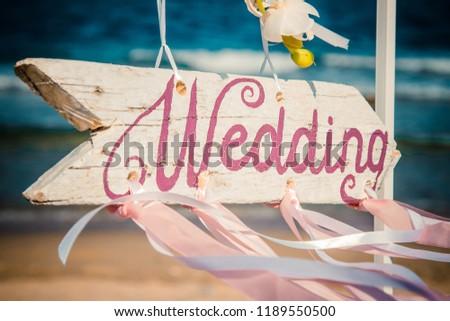 Wedding pointer on the beach  #1189550500