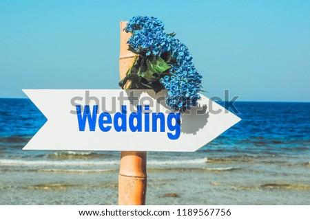 Wedding pointer to the beach #1189567756