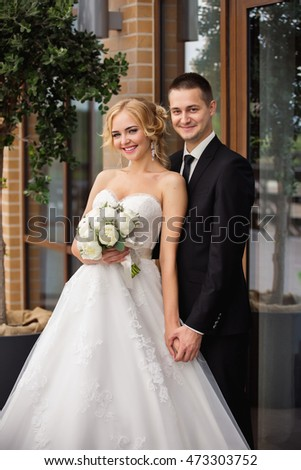 Wedding portrait. Young bride and groom looking at the camera #473303752