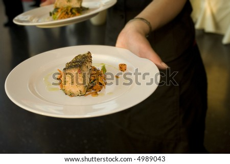 Wedding Reception fine dinning with first course of succulent salmon steak being served
