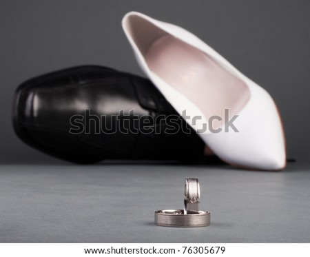 stock photo Wedding ring and shoes with gray background