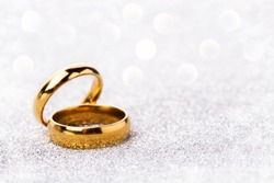 wedding ring celebration background with two gold rings