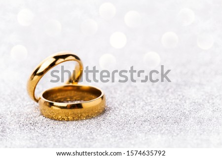 Photo of  wedding ring celebration background with two gold rings