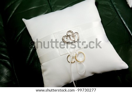 Wedding ring cushion with two rings and love hearts