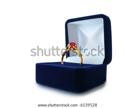wedding ring in box over white